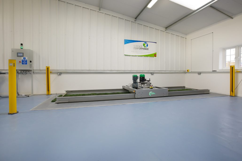 The Lisport XL machine is used to simulate wear on artificial grass in the Surface Performance Ltd test laboratory.